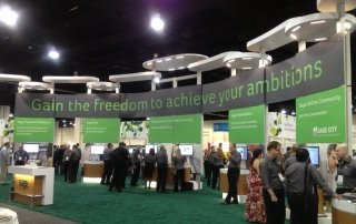 booths at the Sage Summit with small groups of people gathering there