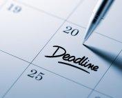 Closeup photo of pen on calendar with 'Deadline