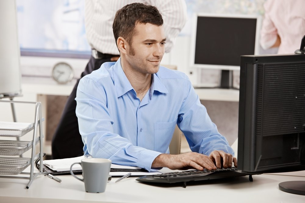 young casual business man at computer in office