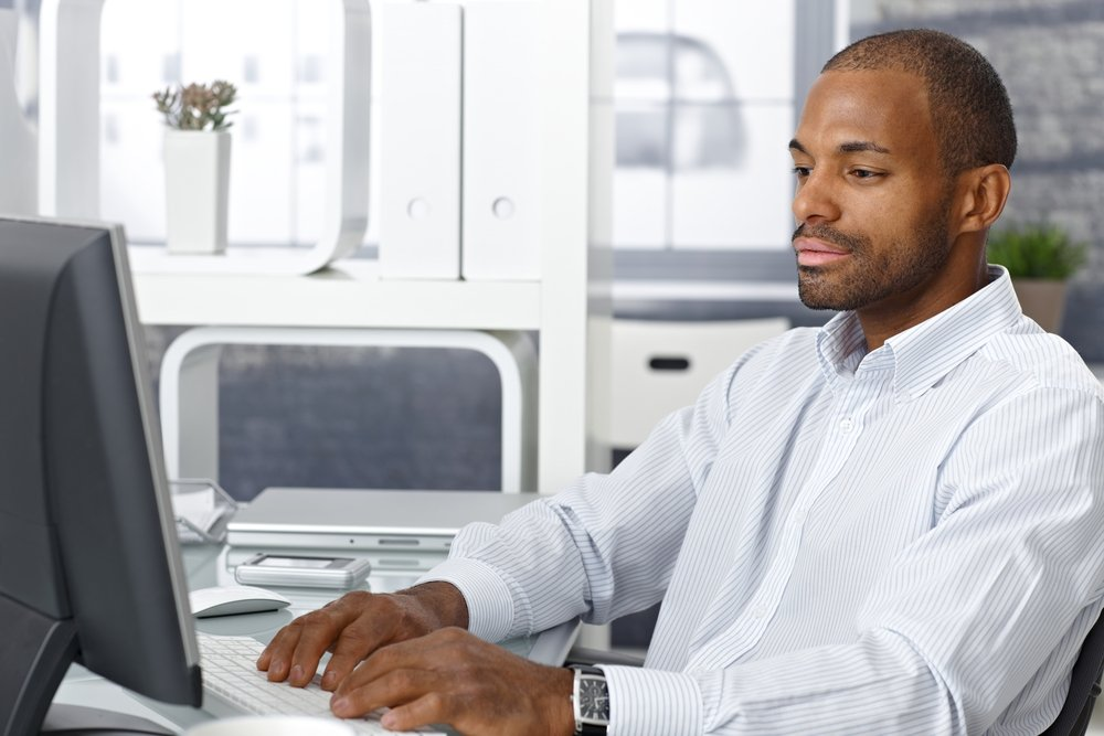 business man working at a desktop computer