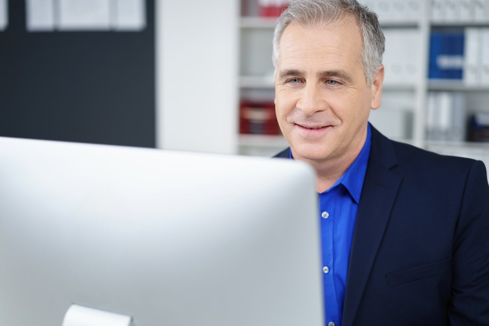 Mature business man working at computer