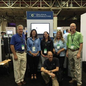 Photo of Delphia Consulting employees at the Delphia Consulting booth at Sage Summit 2015