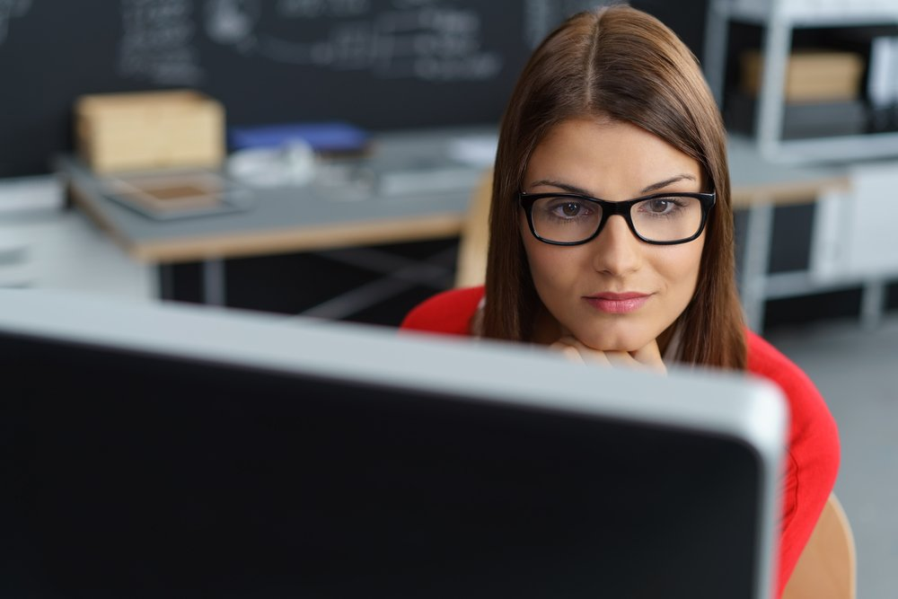 Young business woman looking intently at her computer