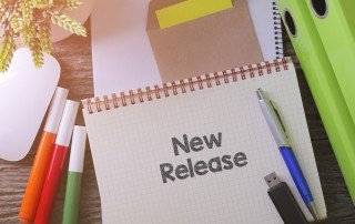 """New Release"" written on notepad"