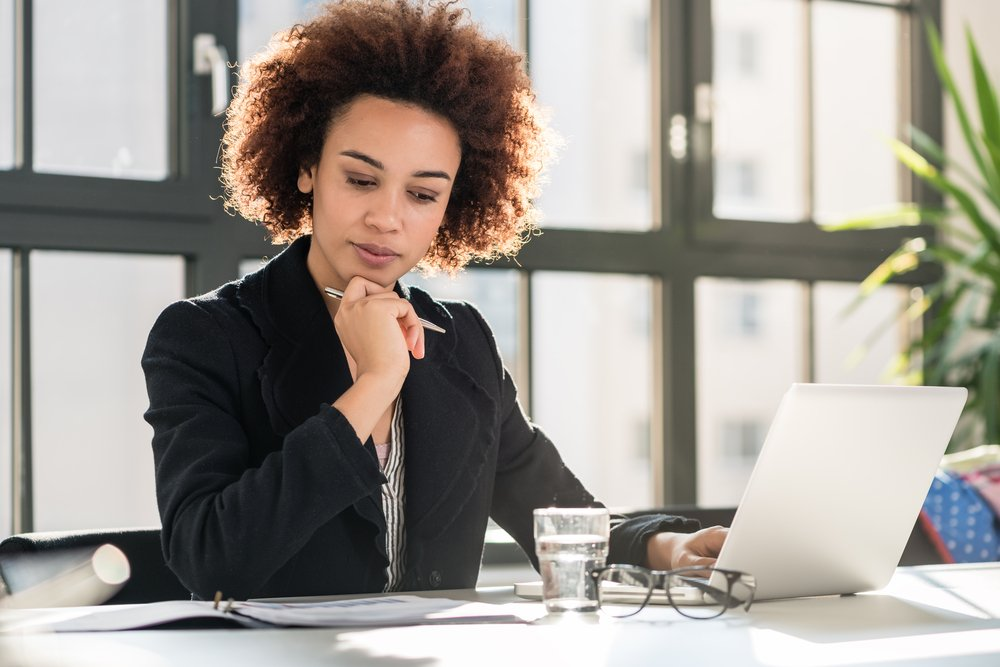 Business woman working at her computer in an office.