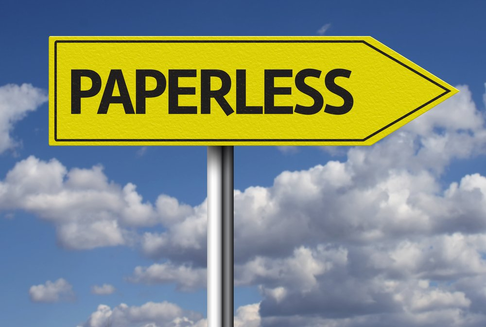 "Yellow arrow sign with the word ""Paperless"" in black"