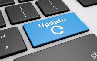 "Closeup photo of blue ""Update"" key on computer keyboard"