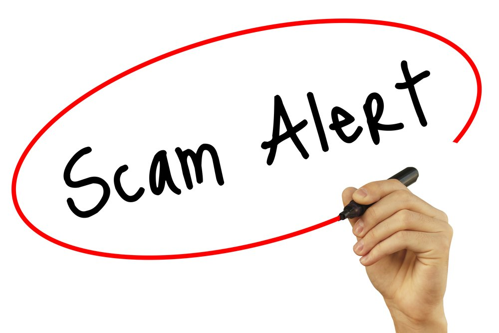 "The words ""Scam Alert"" on white background with hand drawing a red oval around the words"