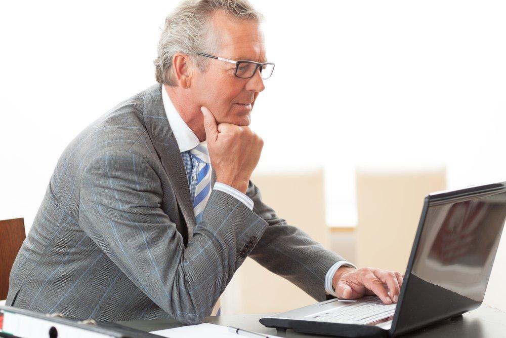 Mature business man working on a laptop computer.