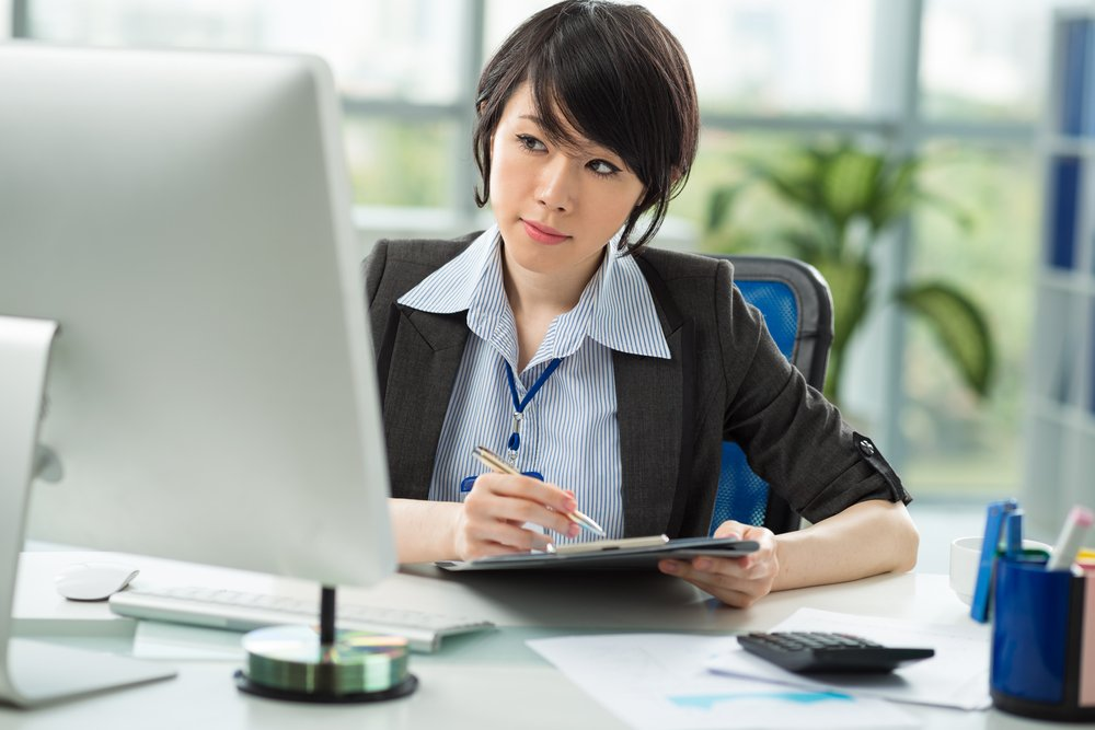 Young woman working at desktop computer
