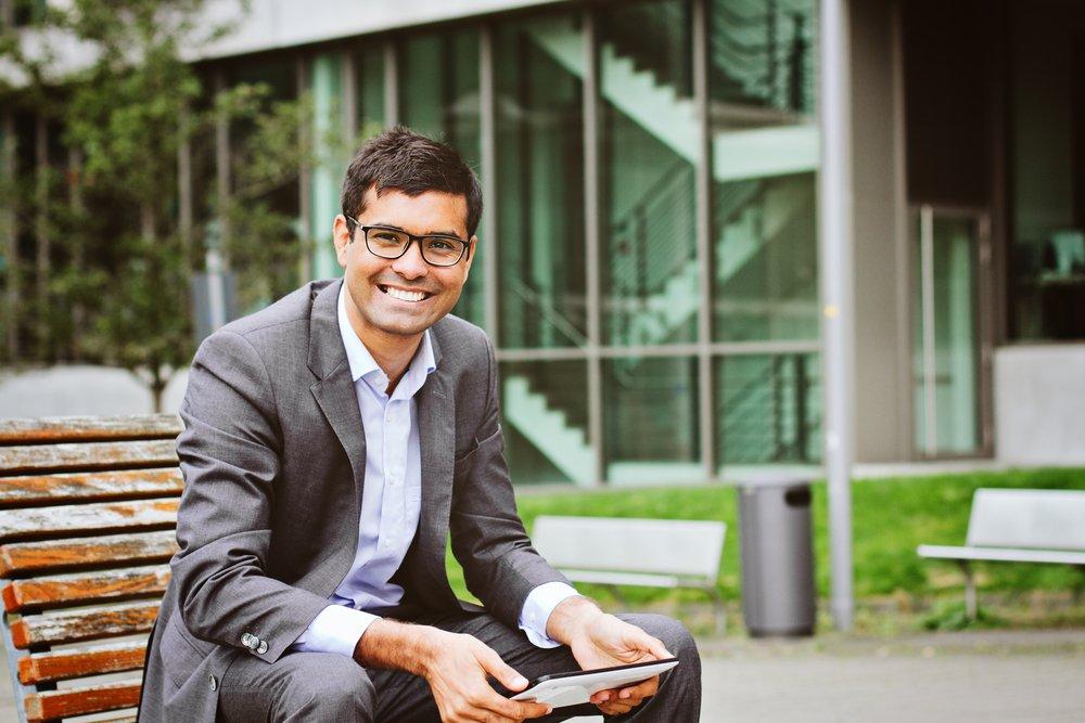Young business man outside using his tablet