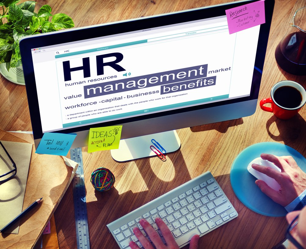 "Computer Monitor with ""HR management"" on screen in ofice"