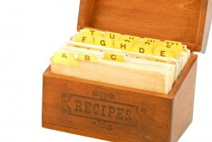 Old, wooden recipe box with indexed dividers and recipe cards