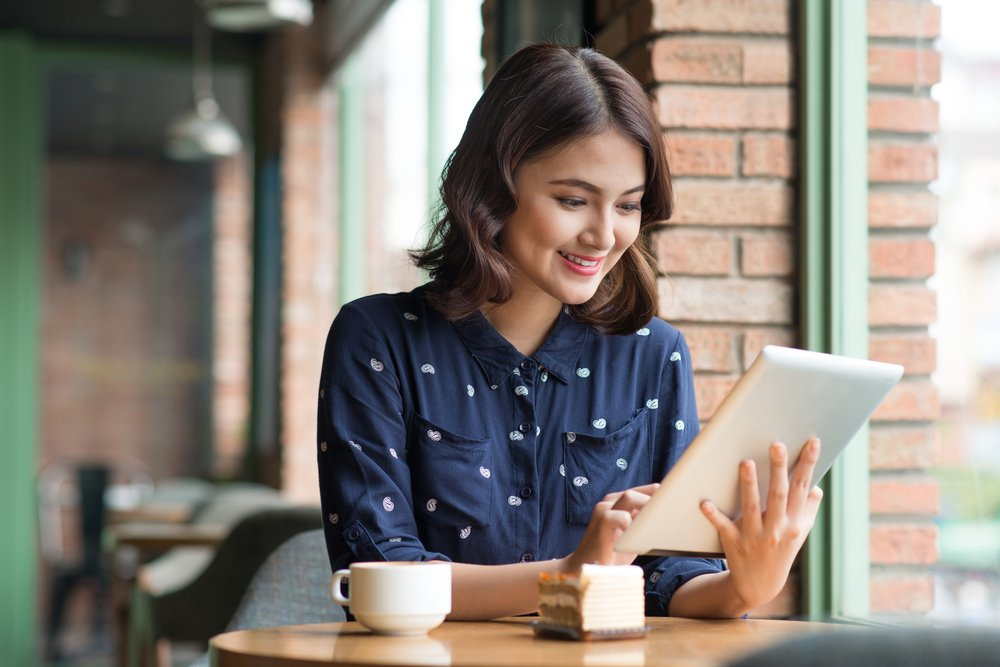 Young woman using a tablet in a cafe