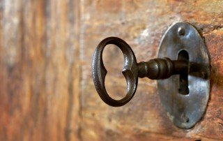 Close up of antique key in old door's keyhole