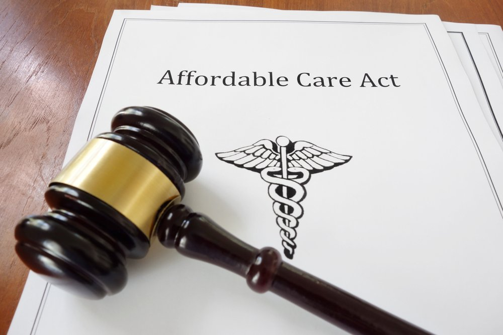 """Gavel lying across a document with """"Affordable Care Act"""" written on the title page"""