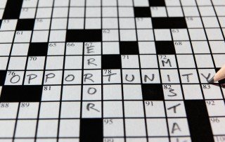 "Crossword puzzle with entered words ""mistake'"" ""error'"" amd ""opportunity."""