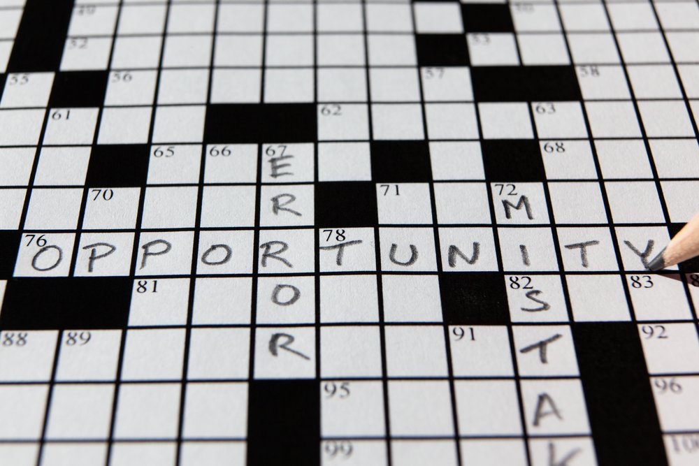 """Crossword puzzle with entered words """"mistake'"""" """"error'"""" amd """"opportunity."""""""
