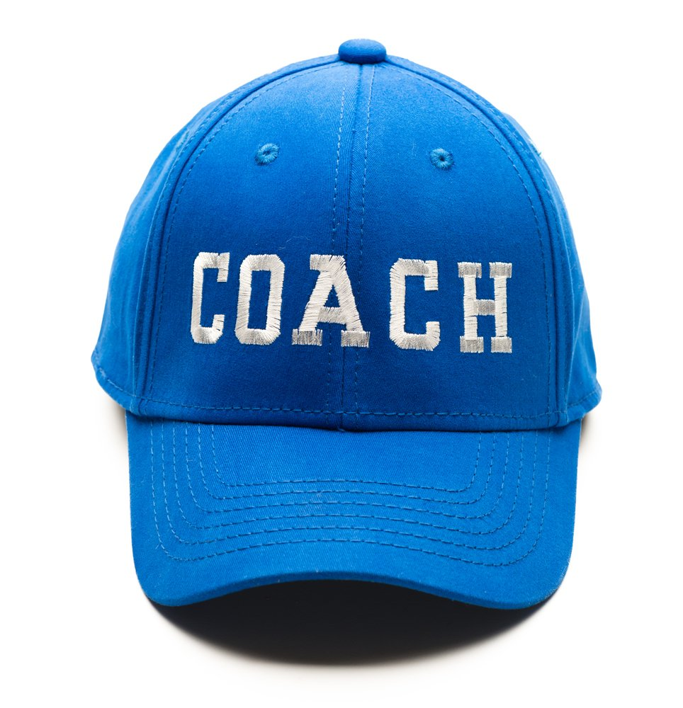 "Blue baseball cap with ""COACH' in white letters"
