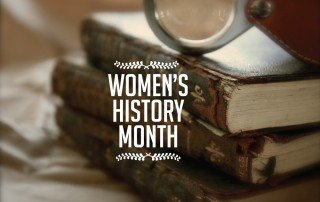 "Words ""Women's History Month"" with background of antique books"