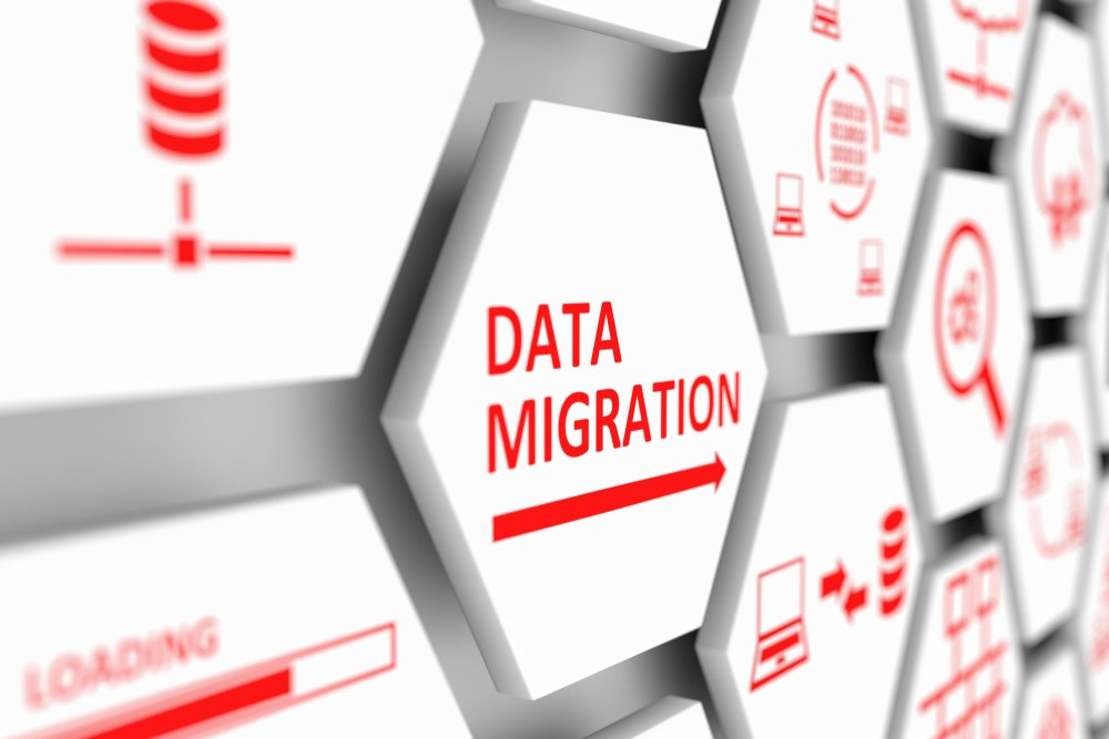 "Wall of white hexagons with red images and words including ""Data Migration"" and database icon"