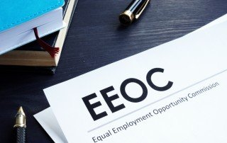 EEOC Equal Employment Opportunity Commission letterhead with pen on desk