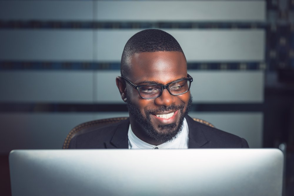 Happy businessman working at office computer