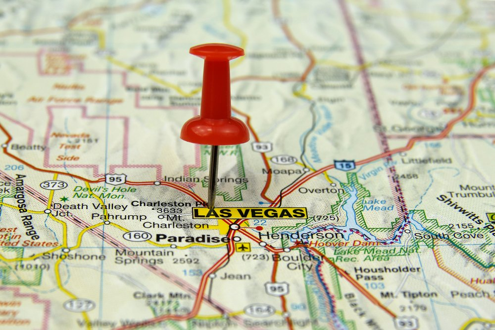 Close up of red push pin in a map making Las Vegas