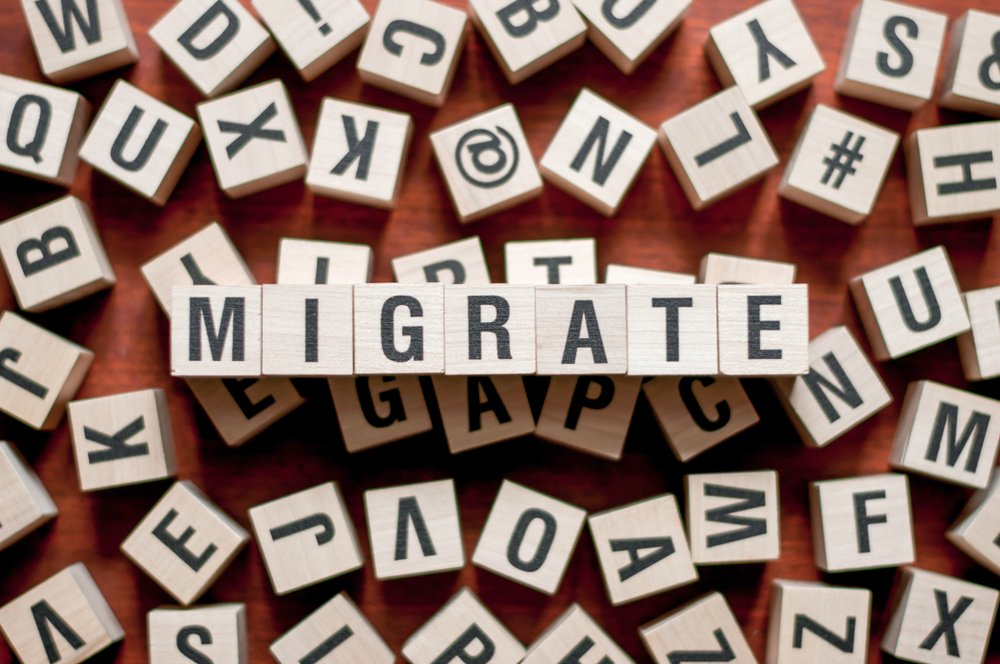"Word ""Migrate"" spelled out with blocks"