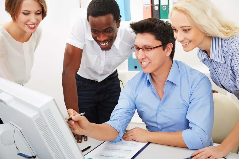 Diverse group of young business people working together in office