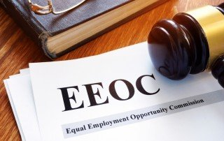 "Gavel resting on paper with ""EEOC"" Header"